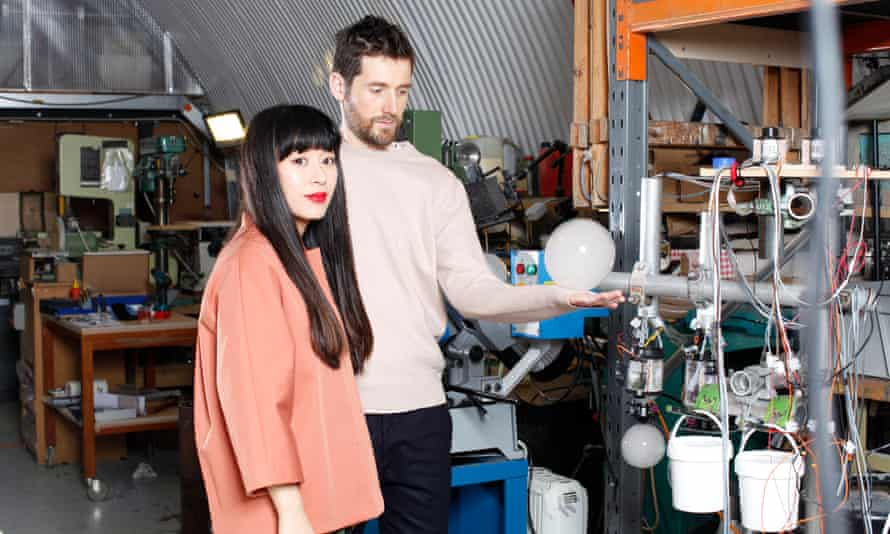 Hands on: Azusa Murakami and her husband and design partner Alexander Groves, testing out one of their bubbles.