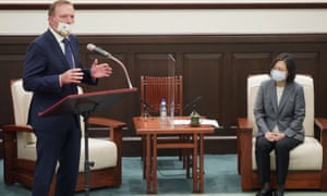 Former Australian prime minister Tony Abbott speaks next to Taiwan's president Tsai Ing-wen during their meeting in Taipei, Taiwan