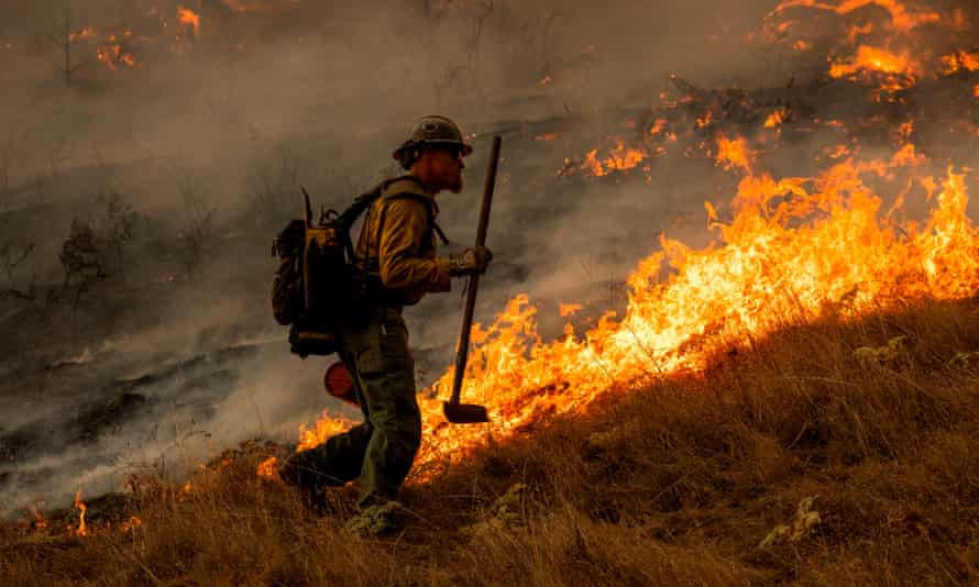 A firefighter during operations to battle the Kincade fire in Healdsburg, California, on 26 October.