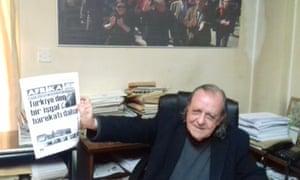 Şener Levent holds a copy of Afrika