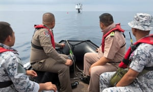 Thai naval officers and marine police inspect a 'seastead' in the Andaman Sea off the coast of Phuket island, southern Thailand.
