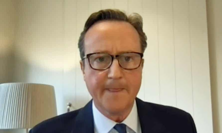 David Cameron's face, wearing glasses and looking stressed