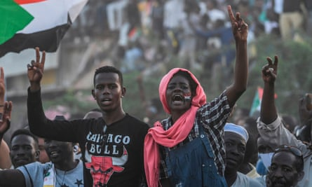 Sudanese protesters outside the army HQ in the capital, Khartoum, on 25 April.
