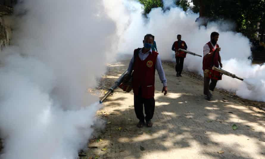 An employee of Dhaka North City Corporation sprays pesticides to kill mosquitoes