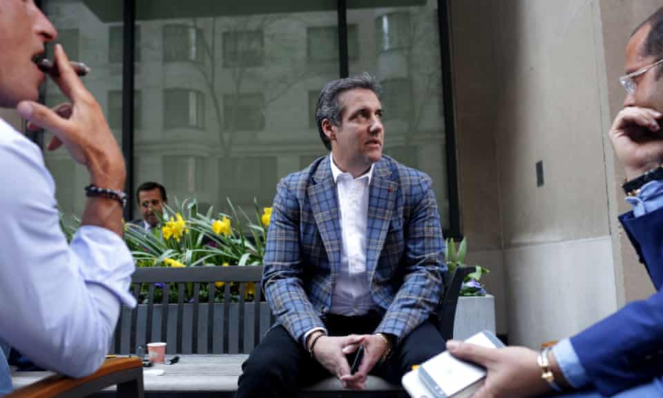 Michael Cohen, chats with friends on Park Avenue in April.