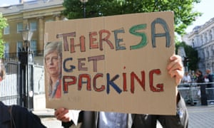 Protesters gathered outside Downing Street following the hung parliament vote with a sign saying 'Theresa get packing'.