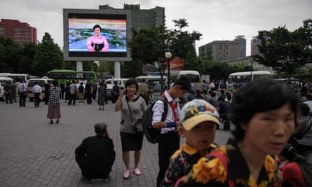 A television screen shows news reader Ri Chun-hee announcing the arrival of North Korean leader Kim Jong-un to Singapore in 2018