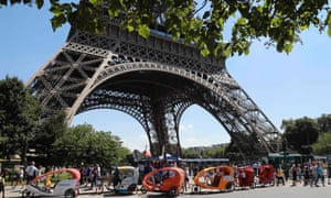 Pedicab drivers waiting for clients near the Eiffel Tower in Paris.