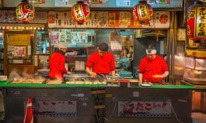 Eat street … a takoyaki stall in Osaka's Dotonbori.