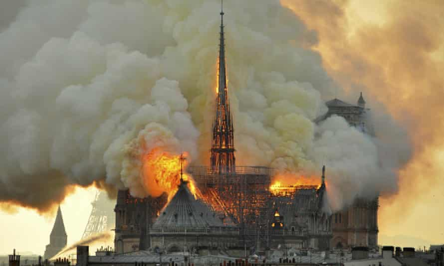 Flames and smoke rise from Notre Dame Cathedral in Paris on Monday.