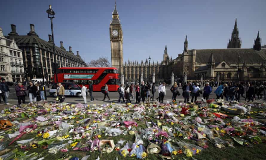 Floral tributes to the victims of the Westminster attack are placed outside the Palace of Westminster, London.