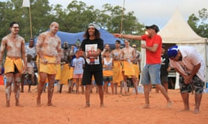 Comedians Steven Oliver and Aaron Fa'aoso are called forward during the bungul dance at the Garma festival.