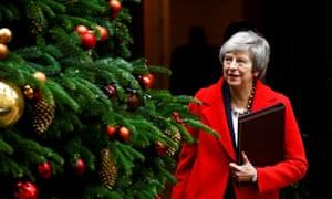 Theresa May passes Christmas tree in Downing Street.