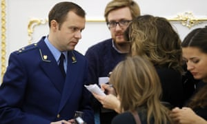 The Russian prosecutor general's office spokesman, Alexander Kurennoi (left), after a press briefing about the charges brought against Bill Browder