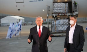 Benjamin Netanyahu (L) and Health Minister Yuli-Yoel Edelstein attend the arrival of a shipment of the Pfizer Coronavirus vaccines, at Ben Gurion Airport.