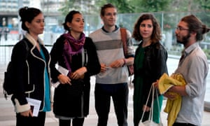 Some of the activists wait for their trial at the courthouse in Paris on 11 September.