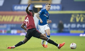 Everton's Lucas Digne tries to find a way past Aaron Wan-Bissaka of Manchester United.