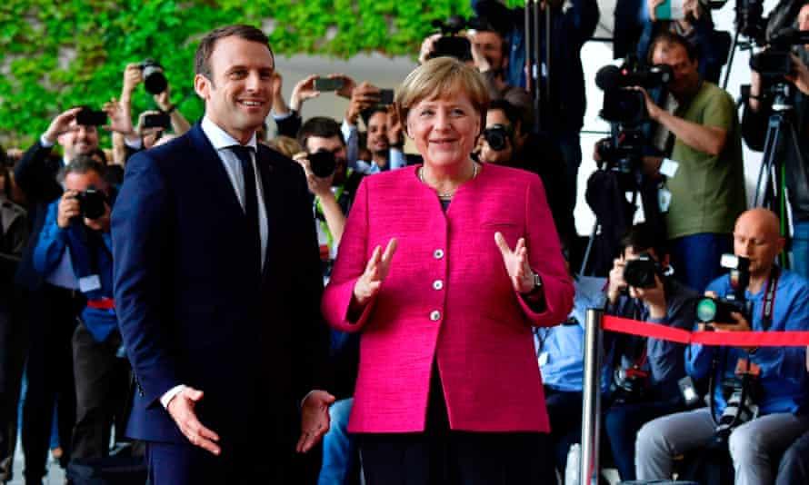 French President Emmanuel Macron  is greeted by German Chancellor Angela Merkel  in Berlin in 2017