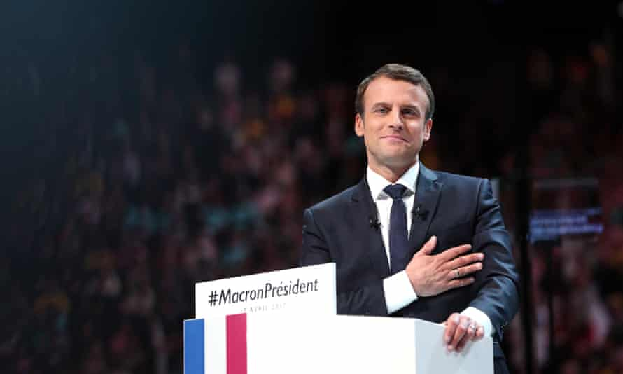 Emmanuel Macron addresses his supporters at a rally in Paris.