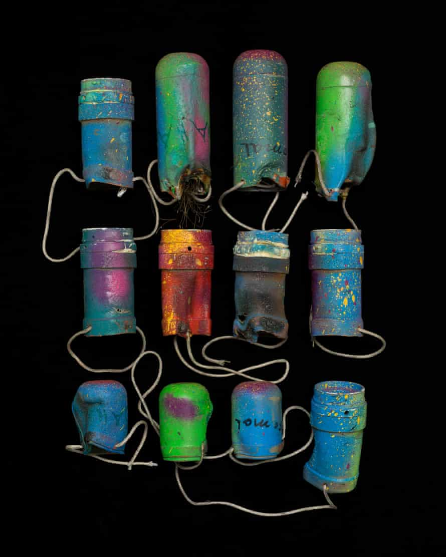 Empty teargas canisters remade into hanging plant pots.