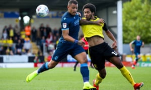 Burton's Richard Nartey challenges Jonson Clarke-Harris of Bristol Rovers on his debut for Albion.