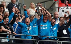 Micky Mellon and his staff celebrate afterwards.
