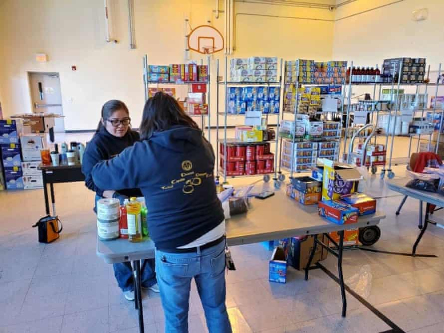 Volunteers sorting and sanitizing supplies at a distribution point in Tuba City Juvenile detention center, Arizona.