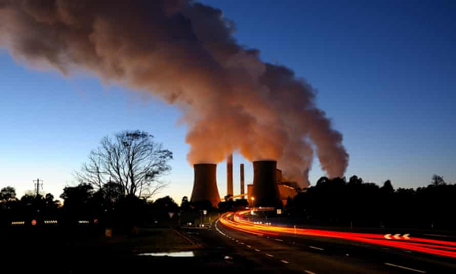 Steam from coal-fired power station at dusk