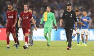 Klopp and his players troop off after losing their previous Champions League away game at Napoli