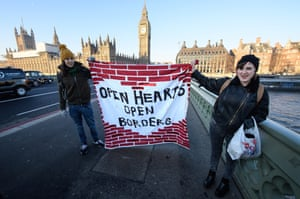 London Protesters hold a banner on Westminster Bridge