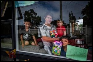 Busuttil at home with her three children, Owen, 8, Scarlet, 4, and Logan, 18 months.
