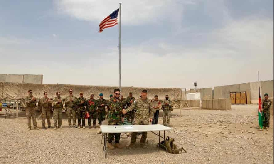 A handover ceremony at Camp Anthonic, from the US army to Afghan defense forces in Helmand province, Afghanistan, on 2 May.