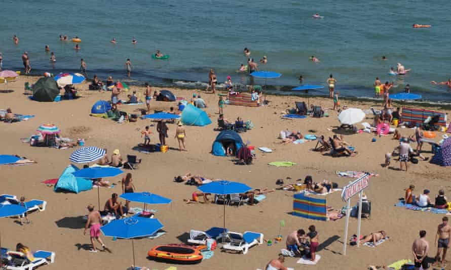 People take advantage of the warm weather in Broadstairs, Kent.