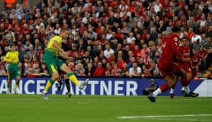 Norwich City's Marco Stiepermann shoots at goal as Liverpool's Virgil van Dijk attempts to block.