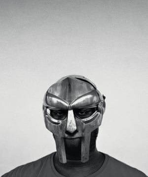 "MF Doom, Los Angeles, 2003. Says photographer Eric Coleman: ""I met Doom first as 'Dumile', the person, not the rapper, and was like, 'OK, this is what he looks like'. He was wearing a red Polo T-shirt because he was a 'Polo head'. Once I 'normalised' him as a regular person, I could then photograph him with the mask. When Doom put on the mask, things became surreal. Suddenly, I was photographing a mask and not the person; the guy behind it almost didn't matter. And that's when the portrait happened. I shot about five rolls with my Fuji GA645 and Hasselblad against a white wall at the house."""
