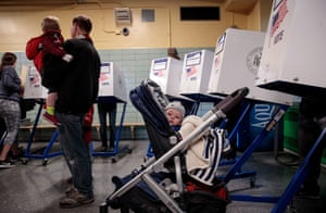 New York: A baby waits as people vote at a polling site at Public School 261 in New York City