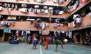 Boys play football in Jakarta