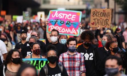 People march in Louisville, Kentucky, on 26 September.