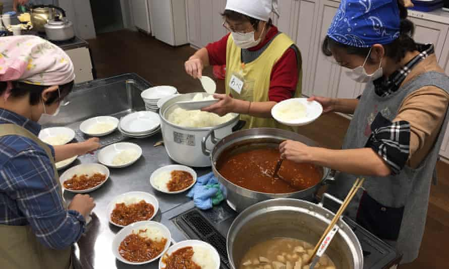 Volunteers prepare meals at a children's cafeteria in Kawaguchi, Saitama prefecture, Japan.