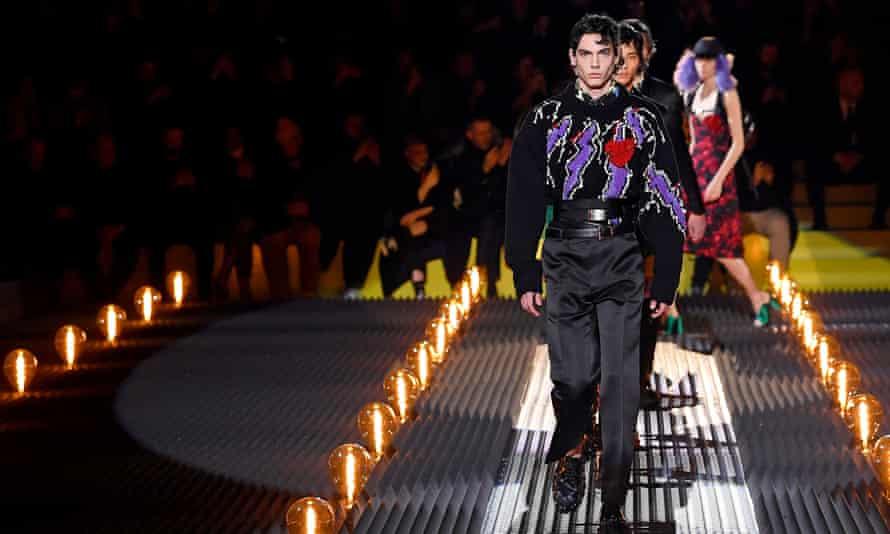 A man wears a lightning bolt jumper on the catwalk
