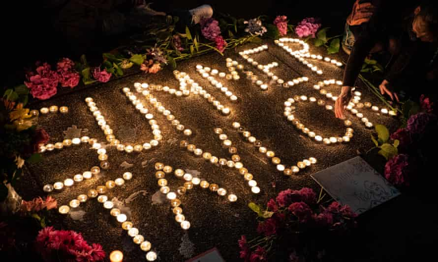Protesters hold a vigil to honor Summer Taylor, who died after they were hit by a car during a recent protest, on 5 July in Seattle, Washington.