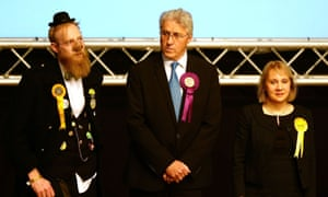 Oldham West and Royton Ukip candidate John Bickley at the byelection results with Sir Oink Alot of the Official Monster Raving Party (left) and the Liberal Democrats' Jane Brophy.