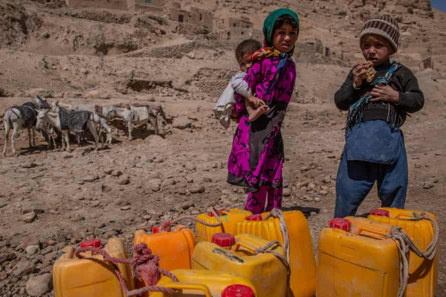 Children are often responsible for fetching water in Afghanistan, and have to walk long hours due to the drought