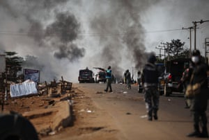 Police fire teargas at people during clashes between youths in Apo following the ongoing demonstrations against the unjust brutality of the Nigerian police force unit, the special anti-robbery squad.