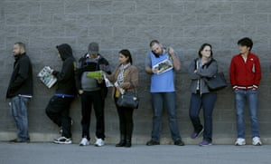 Kansas, US People wait in line for a Best Buy store to open for a Black Friday sale on Thanksgiving Day