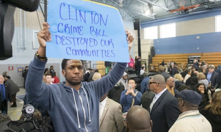 "Protester Rosco Farmer is corralled in the back of the auditorium by civil affairs officers near the end of former President Bill Clinton rally for Democratic presidential candidate Hillary Clinton, Thursday, April 7, 2016, in Philadelphia. Bill Clinton was interrupted by people in the crowd holding signs reading ""Clinton crime bill destroyed our communities"" and ""Welfare reform increased poverty."" (Ed Hille/The Philadelphia Inquirer via AP) PHIX OUT; TV OUT; MAGS OUT; NEWARK OUT; MANDATORY CREDIT"