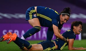 Lyon's Saki Kumagai (right) celebrates with Lucy Bronze after scoring their second goal in the 3-1 win against Wolfsburg at the Anoeta Stadium.