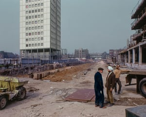 Watney Market, 1974. During the building of 2 tower blocks and shopping area that replaced some very run-down housing south of Commercial Road in Whitechapel. A possible difference of opinion going on here.