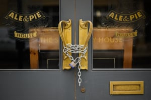 A padlock and chain secures the door of a temporarily-closed pub on 10 February, 2021 in London, England. With a surge of Covid-19 cases fueled partly by a more infectious variant of the virus, British leaders have reimposed nationwide lockdown measures across England through at least mid February.