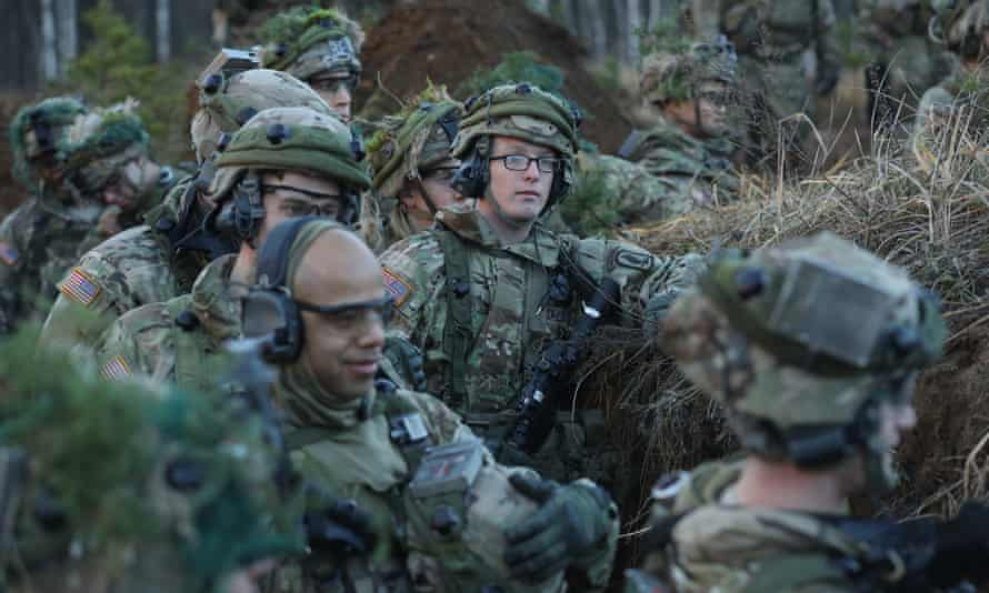 US soldiers occupy an enemy trench during Nato military exercises on 24 November.